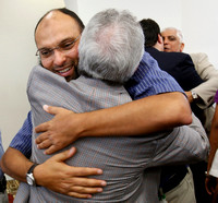 Ahmed Ragad greets Saleh Sbenaty after the first service in the new Islamic Center in Murfreesboro, Tennessee