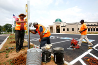 Handicap parking signs are placed prior to the first service at the new Islamic Center in Murfreesboro, Tennessee