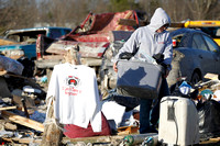 "A shirt proclaiming ""I can't take it anymore"" hangs amid the debris of homes where several people died in tornado destruction in East Bernstadt, Kentucky"
